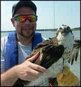 Dr, Brian Washburn with osprey