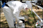 NWDP Wildlife Disease Biologist participates in an emergency response exercise in full protective gear.