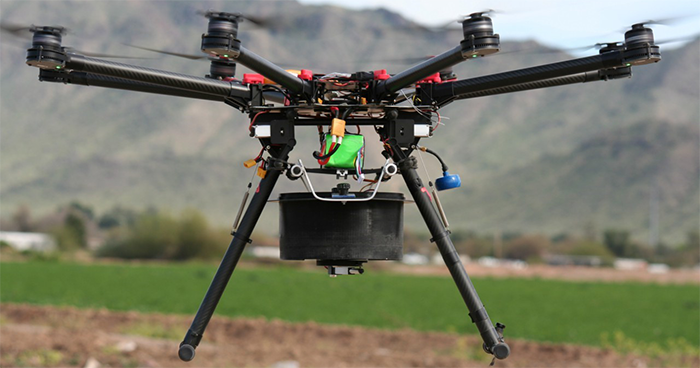 In 2016, PPQ evaluated the performance of a multi-rotor unmanned aircraft system capable of vertical takeoff and landing. The UAS carries a sterile insect release device between its landing skids.